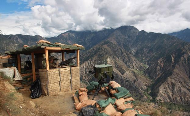 עמדת שמירה באזור ההררי באפגניסטן (צילום: John Moore, GettyImages IL)