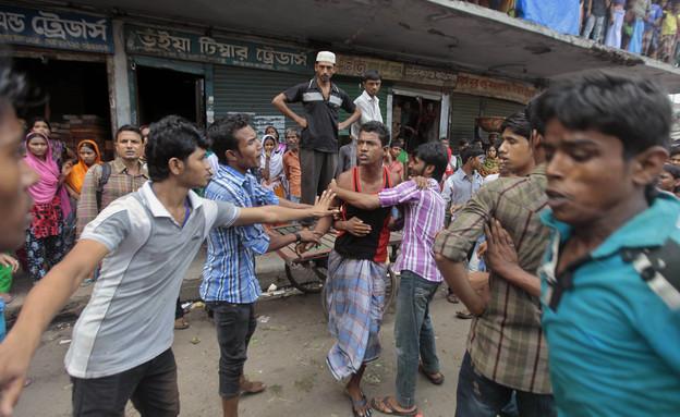 הפגנת עובדי הטקסטיל בבנגלדש (צילום: ap)