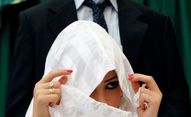 """תושב ת""""א התאסלם ונישא לפלסטינית. אילוסטרציה (צילום: רויטרס)"""