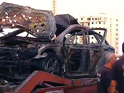 פינוי שרידי הרכב באשקלון (צילום: חדשות 2)