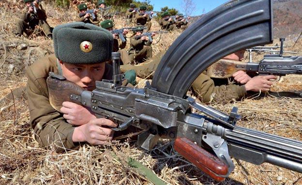 שרירים צפון קוריאנים (צילום: רויטרס)