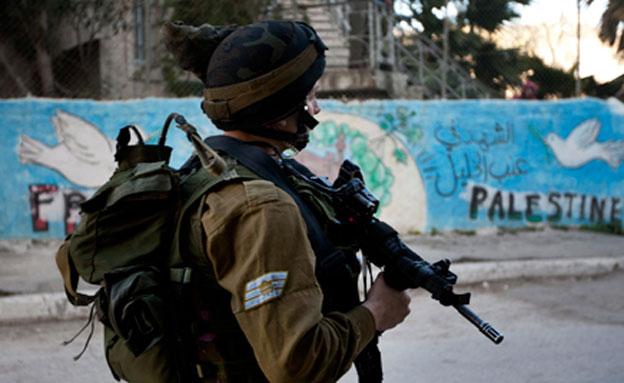 """הפלסטינים: צה""""ל ירה והרג בן 14 (צילום: AP)"""