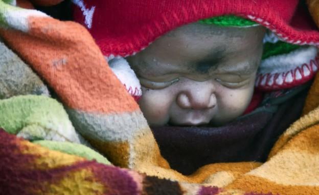 צעדה ימים כדי ללדת תינוק (צילום: טים ווילמור, certers news)