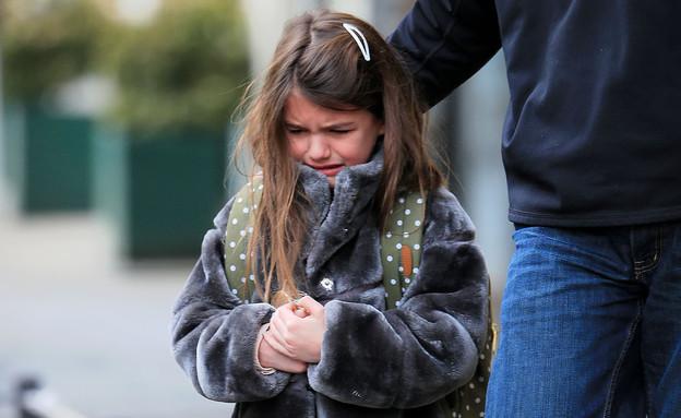 סורי קרוז בוכה בדרך לבית ספר (צילום: Jackson Lee / Splash News, Splash news)