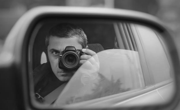 חוקא פרטי מצלם מתוך המכונית (צילום: אימג'בנק / Thinkstock)