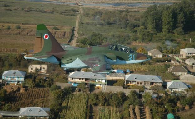 מטוס סוחוי גיאורגיה מעל גיאורגיה (צילום: חיל האוויר הגיאורגי)