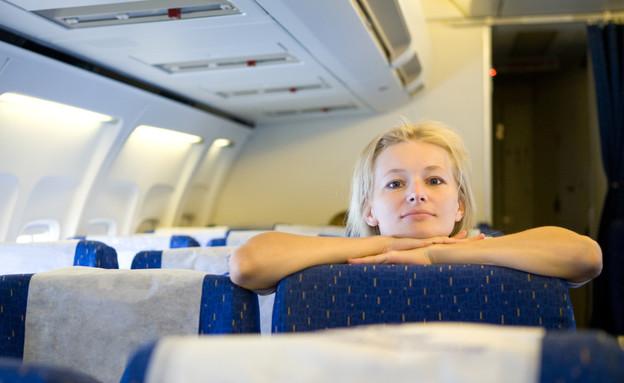 נוסעת במטוס (צילום: אימג'בנק / Thinkstock)
