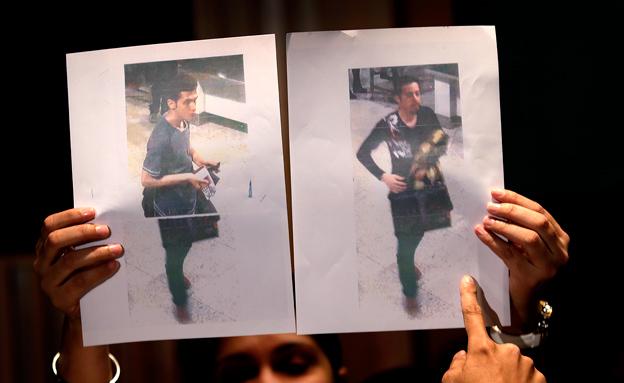נחשפו תמונות החשודים שעלו עם דרכון מזויף (צילום: AP)