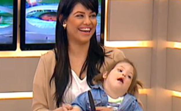 גרייס סוויסה - אמא לילד עם תסמונת דאון (תמונת AVI: הבוקר של קשת )