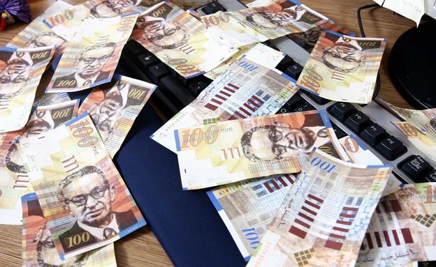 שטרות כסף (צילום: עודד קרני)