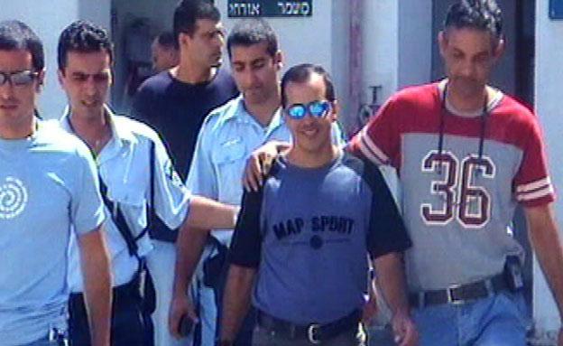 אילן קופרמן סגל במעצר (צילום: חדשות 2)