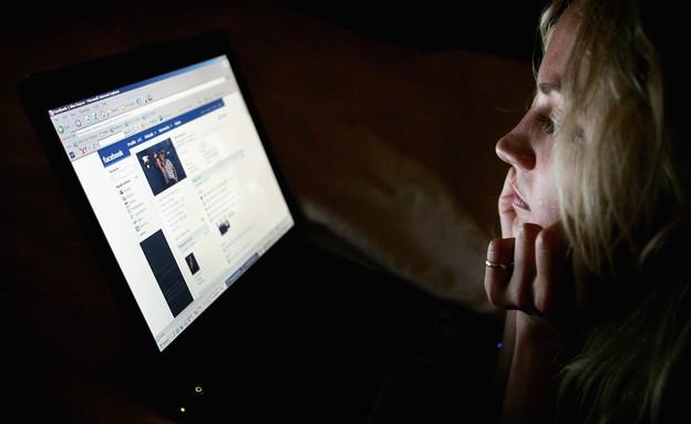 אישה בפייסבוק (צילום: Chris Jackson, GettyImages IL)