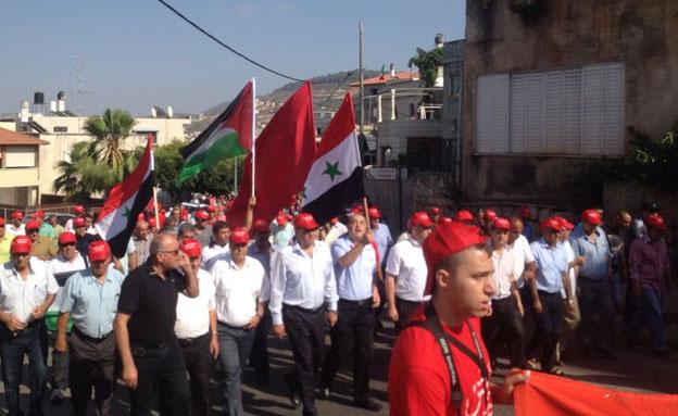 """הפגנה בסכנין: """"ישראל מדינת טרור"""" (צילום: פוראת נאסר חדשות 2)"""