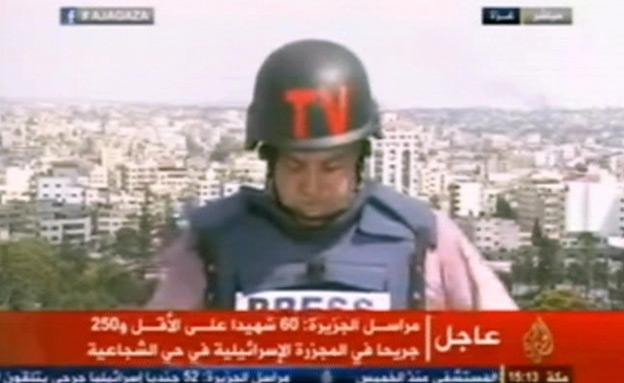 צפו: כתב אל-ג'זירה בוכה בשידור (צילום: אל ג'זירה)