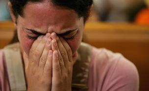 נערה עצובה (צילום: Spencer Platt, GettyImages IL)