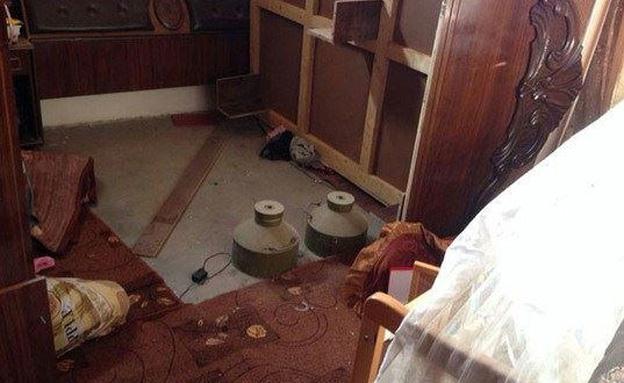 """מטענים שהוחבאו בבית בעזה (צילום: דובר צה""""ל)"""