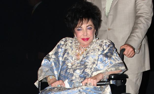 ג'ואן ריברס - אליזבת' טיילור (צילום: Frederick M. Brown, GettyImages IL)