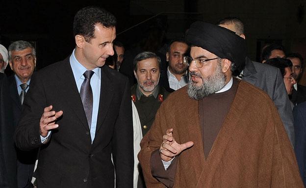 חסן נסראללה ומחמוד אסד (צילום: AP)