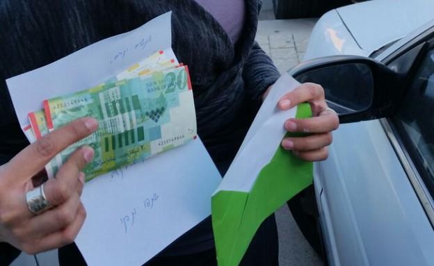 כסף מתורם אלמוני בכפר סבא (צילום: אירית מארק, 'השרון הפוסט')