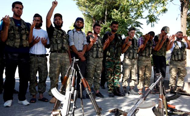 הולכים ונבלמים? כוחות המורדים בסוריה (צילום: רויטרס)