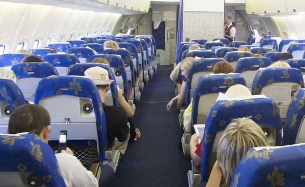 נוסע במטוס נוסעים (צילום: אימג'בנק / Thinkstock)