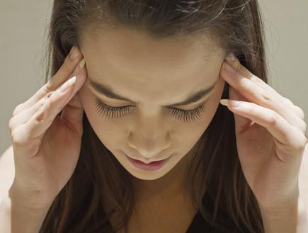 כאב ראש (צילום: אימג'בנק / Thinkstock)