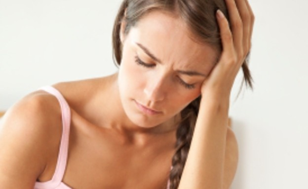 אישה עצובה (צילום: rollover, Istock)
