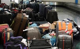 מה קורה למטען אחרי שאתם עולים למטוס? (צילום: רויטרס)