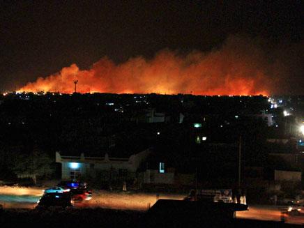 מפעל נשק בוער בחרטום בשנת 2012 (צילום: רויטרס)