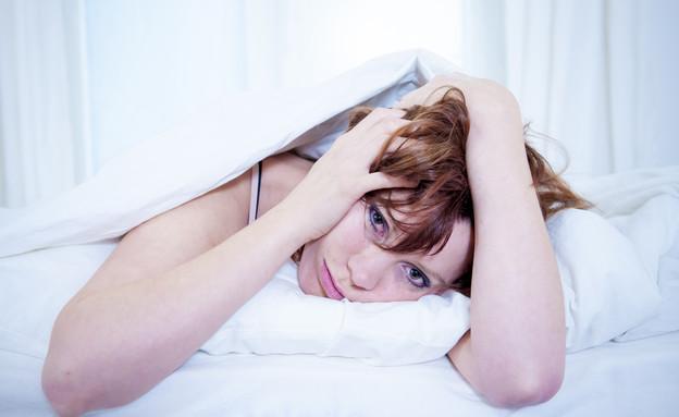 אישה במיטה (צילום: אימג'בנק / Thinkstock)