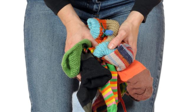 גרביים בודדים מחכים לידיים קטנות (צילום: ThinkstockPhotos)
