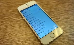 אפליקציית פייסבוק באייפון (צילום: יאיר מור, NEXTER)