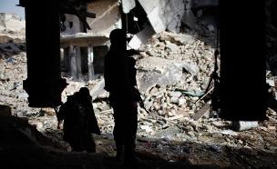 """פעילי דאע""""ש בסוריה, ארכיון (צילום: רויטרס)"""