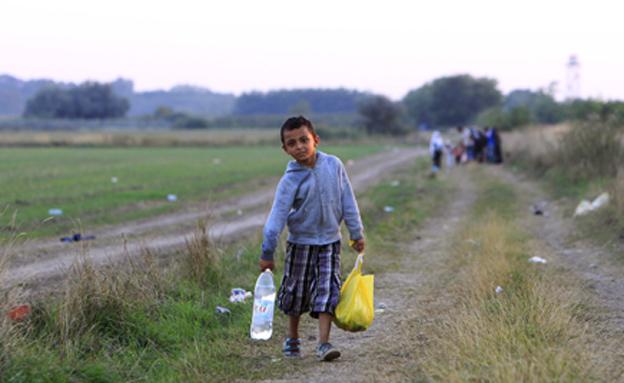 ילד פליט סורי ברוז'קה הונגריה (צילום: רויטרס)