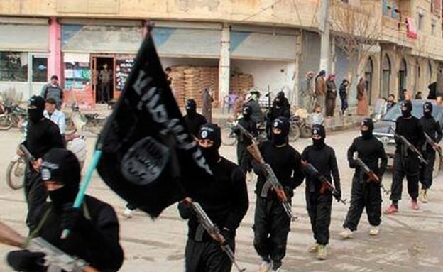לוחמי דאעש בסוריה (צילום: Sakchai Lalit   AP)