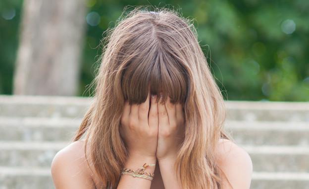 נערה עצובה (צילום: Shutterstock)