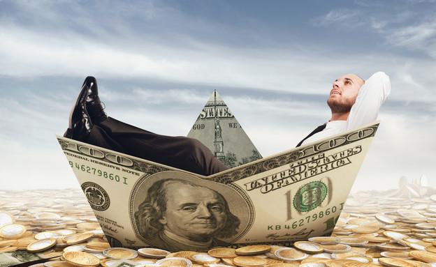 איש שט על שטר כסף (אילוסטרציה: Shutterstock)