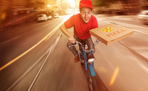 שליח פיצה (צילום: Shutterstock)