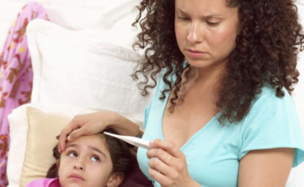 דואגים לילד עם חום (צילום: Tom Le Goff, GettyImages IL)