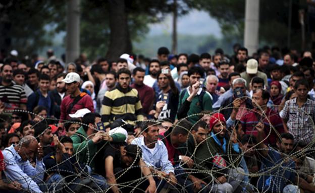 יוחזרו לטורקיה? פליטים בגבול יוון (צילום: רויטרס)