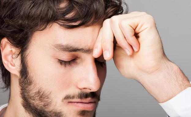 גבר עצוב (צילום: Minerva Studio, Shutterstock)