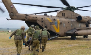 """פינוי פצועים ברמת הגולן (צילום: דובר צה""""ל)"""
