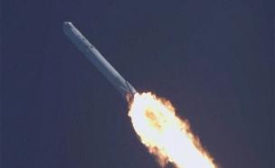 צפו: השיגור המוצלח לחלל - והנחיתה בים (צילום: רויטרס)
