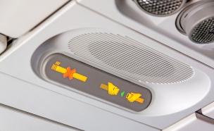 חגורת בטיחות במטוס (צילום: aldorado, Shutterstock)