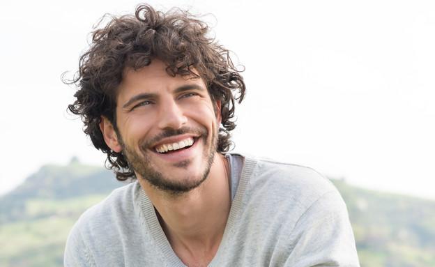 בחור שמח (צילום: Rido, Shutterstock)