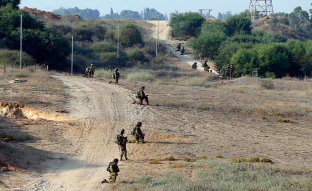 חיילים לוחמים (צילום: רויטרס)