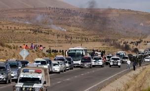 האלימות בחסימת הכביש השבוע (צילום: רויטרס)