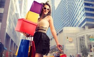 אישה עם קניות (אילוסטרציה: Shutterstock)