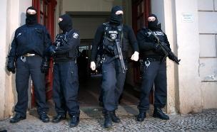 3 נעצרו בפשיטה של משטרת גרמניה (צילום: רויטרס)