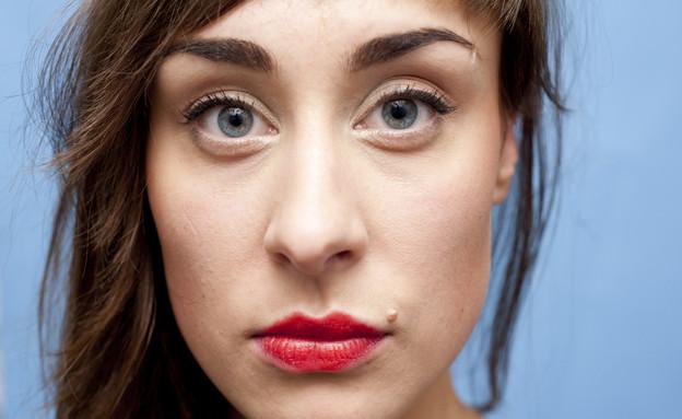 פנים של אישה (צילום: Concept Photo, Shutterstock)